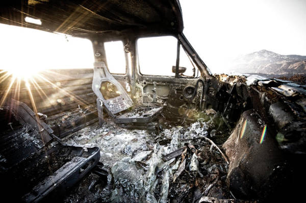 A Burned Out Truck At Sunset Poster