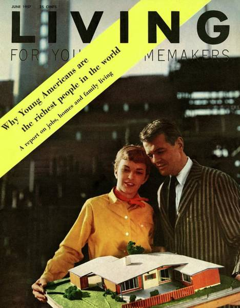 A Couple Looking At A Scale Model Of A House Poster