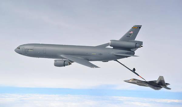 A Kc-10 Extender Refuels An F-22 Raptor Poster