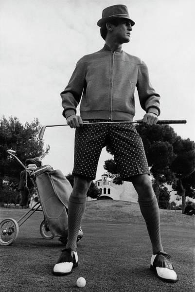 A Male Model Posing As A Golfer Wearing Poster