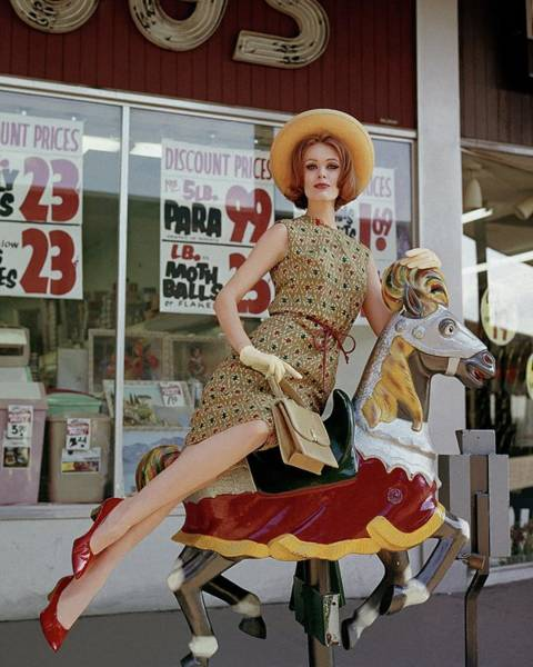 A Model Sitting On A Rocking Horse Poster