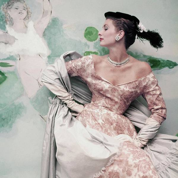 A Model Wearing A Balenciaga Dress Poster