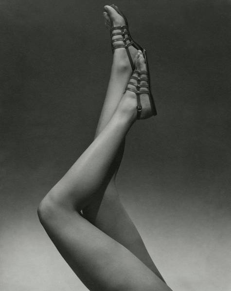 A Model's Legs Wearing Sandals Poster