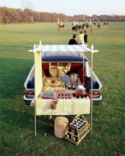 A Picnic Table Set Up On The Back Of A Car Poster