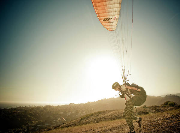 A Young Man Launches His Paraglider Poster