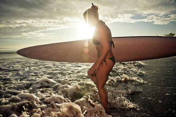 A Young Woman Carries Her Paddleboard Poster