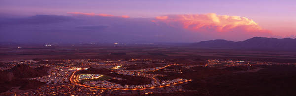 Aerial View Of A City Lit Up At Sunset Poster