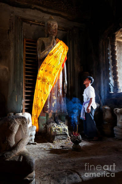 Angkor Wat Devotee Lights Incense In Buddha Temple Poster