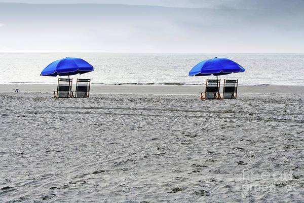 Beach Umbrellas On A Cloudy Day Poster