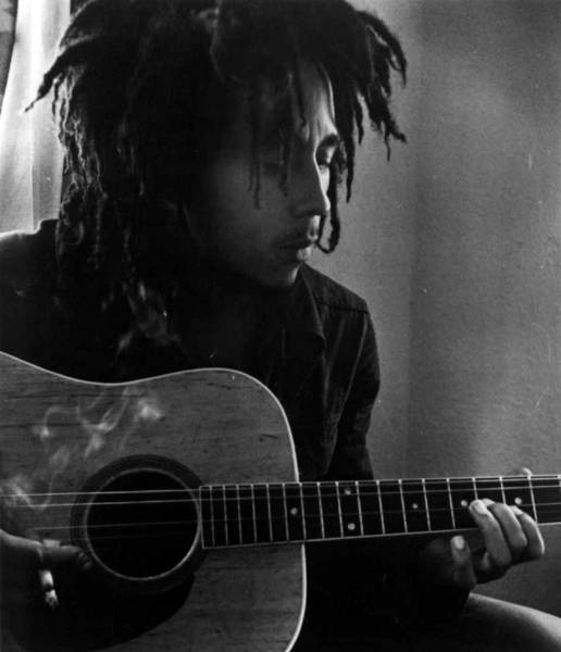 Bob Marley Leaning Over Guitar Poster
