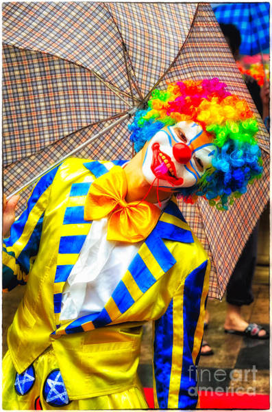 Brightly Dressed Clown With Umbrella Poster