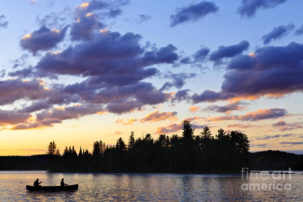 Canoeing At Sunset Poster