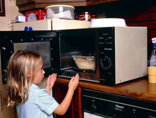 Child Danger: Young Girl Takes Food From Microwave Poster