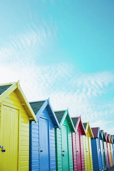 Colourful Beach Huts Along The Seafront Poster