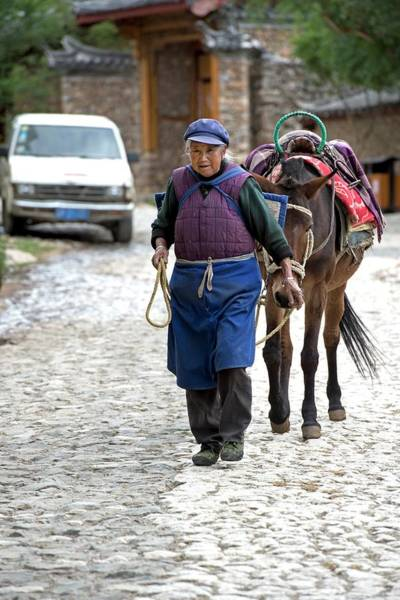 Elderly Naxi Woman With Her Horse Poster
