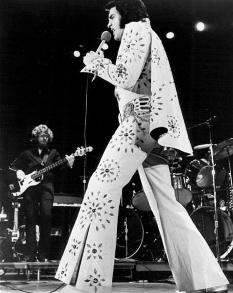 Elvis Presley In White Outfit On Stage Poster