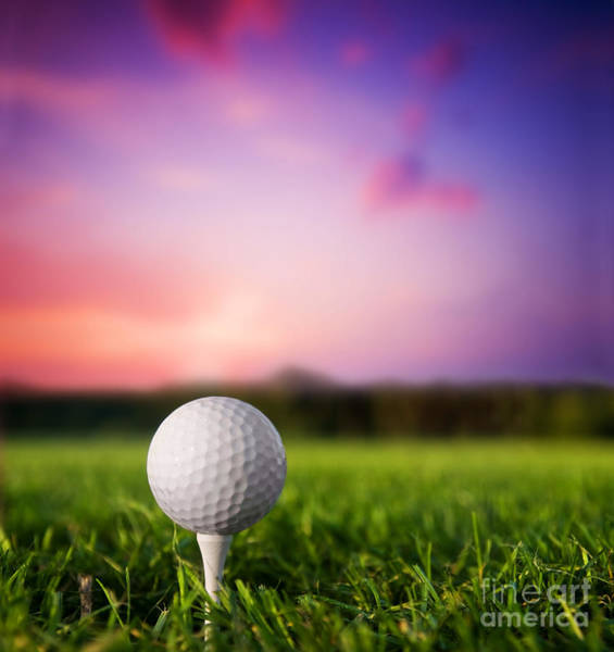Golf Ball On Tee At Sunset Poster