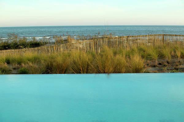 Infinity Pool Alongside The Beach Poster