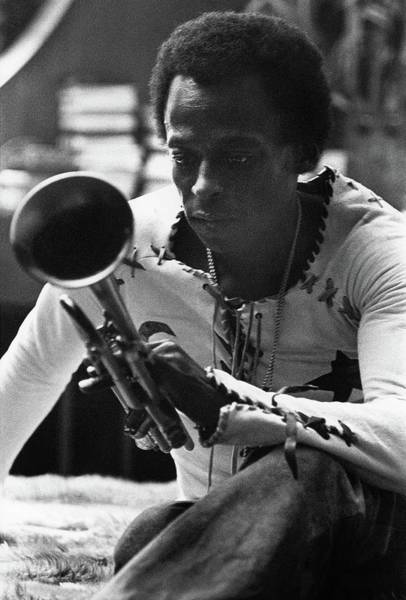 Jazz Musician Miles Davis Looking At His Trumpet Poster
