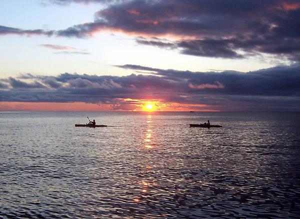 Kayaks At Sunset Poster