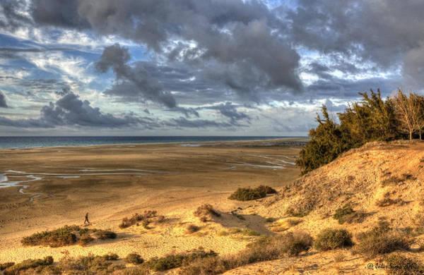 Lone Stroller On A Vast Beach Under Dramatic Sky Poster