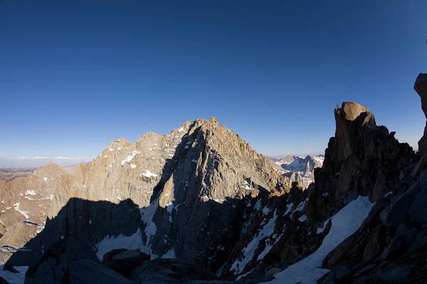 Man Hiking Dramatic Granite Ridge Poster
