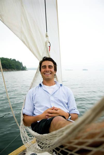 Man Smiling On Hammock Onboard Poster