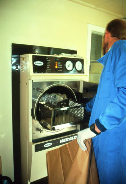 Medical Technician Operating A Hospital Autoclave Poster