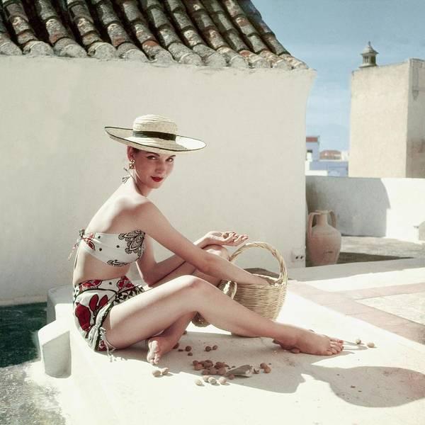 Model Wearing A Calypso Patterned Bikini Poster