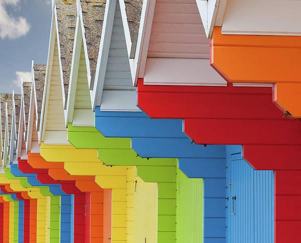 Multi Coloured Beach Huts Poster