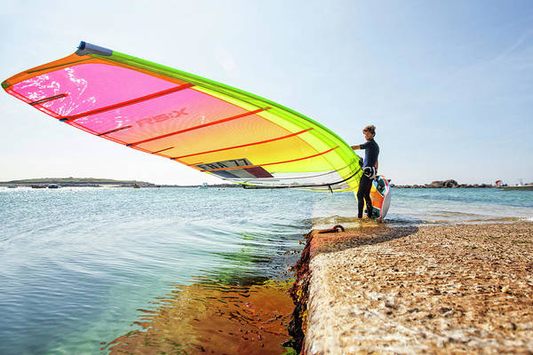 Pierre Le Coq Carries His Windsurfing Poster