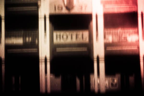 Pinholed Hotel  Poster