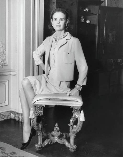 Portrait Of Gloria Vanderbilt Sitting On A Stool Poster