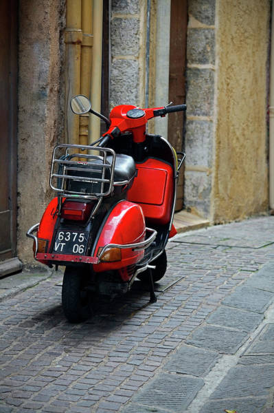 Red Vespa Scooter Parked In Sidestreet Poster