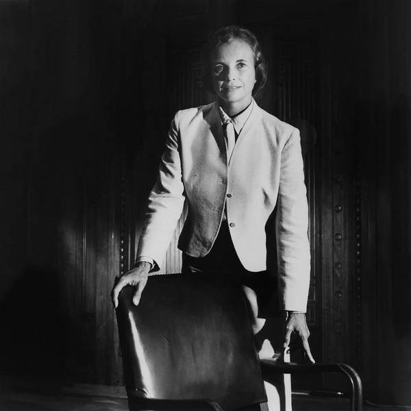 Sandra Day O'connor Posing Beside An Office Chair Poster