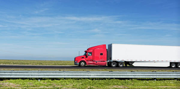 Semi Truck Moving On The Highway Poster