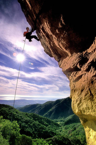 Silhouetted Climber Rapelling Poster
