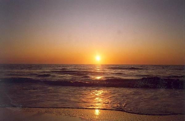 Sun Setting At Ocean Beach Poster