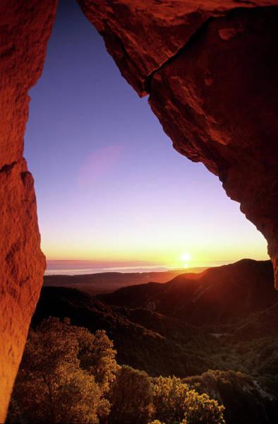 Sunset Landscape Framed  By Rock Faces Poster