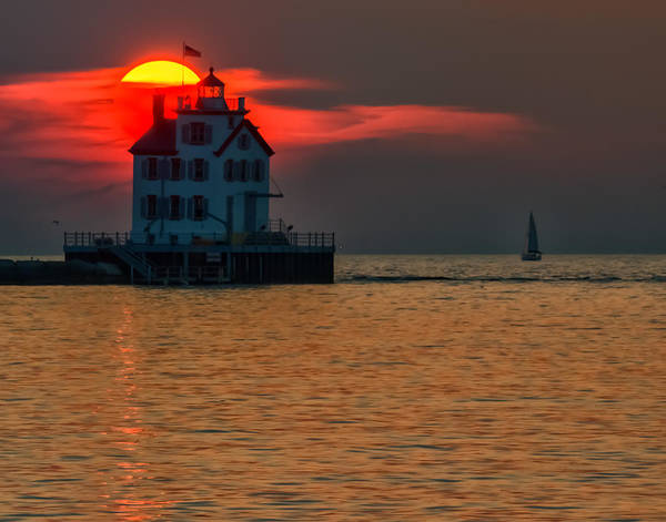 Sunset On Lighthouse Poster