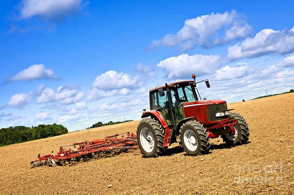 Tractor In Plowed Farm Field Poster