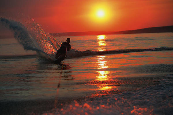 Waterskiing At Sunset Poster
