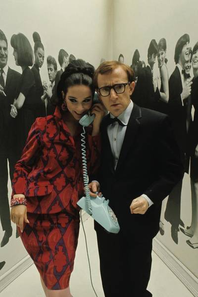 Woody Allen Posing With A Model Holding Poster