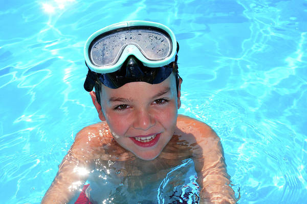 Young Boy In A Swimming Pool Poster