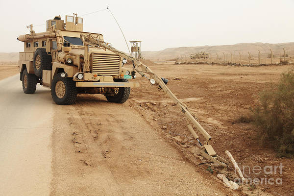 A Mrap Vehicle Disassembles An Poster