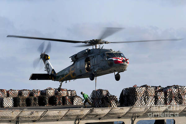 An Mh-60s Sea Hawk Lifts Cargo Poster