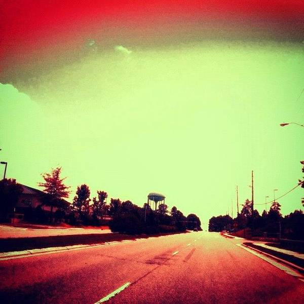 #cary #driving #sky #red #watertower Poster