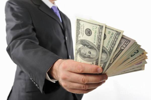Man Holding American Dollars In Fan Shape Poster