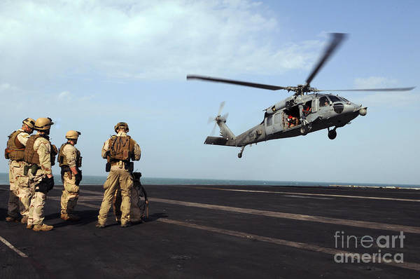 Sailors Prepare To Board An Mh-60s Sea Poster