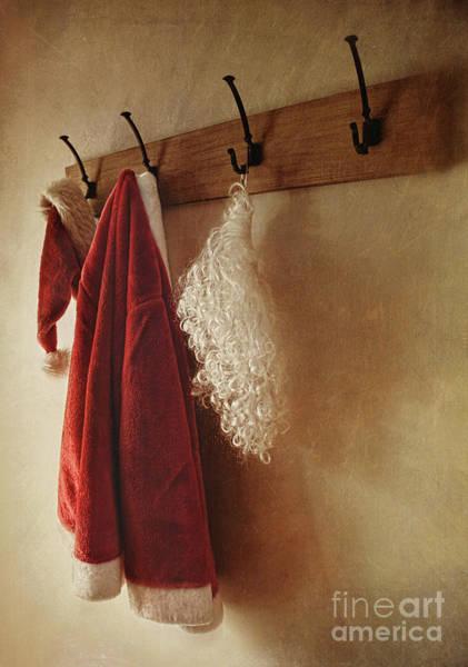 Santa Costume Hanging On Coat Rack Poster